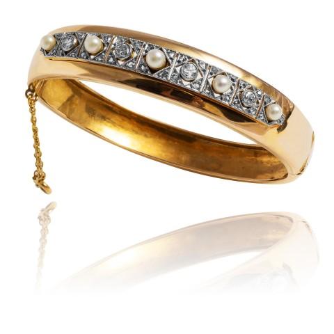 Bransoletka z perłami oraz diamentami wykonana ze złota oraz platyny