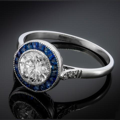 Platynowy pierścionek z brylantem ok. 1.00ct i szafirami